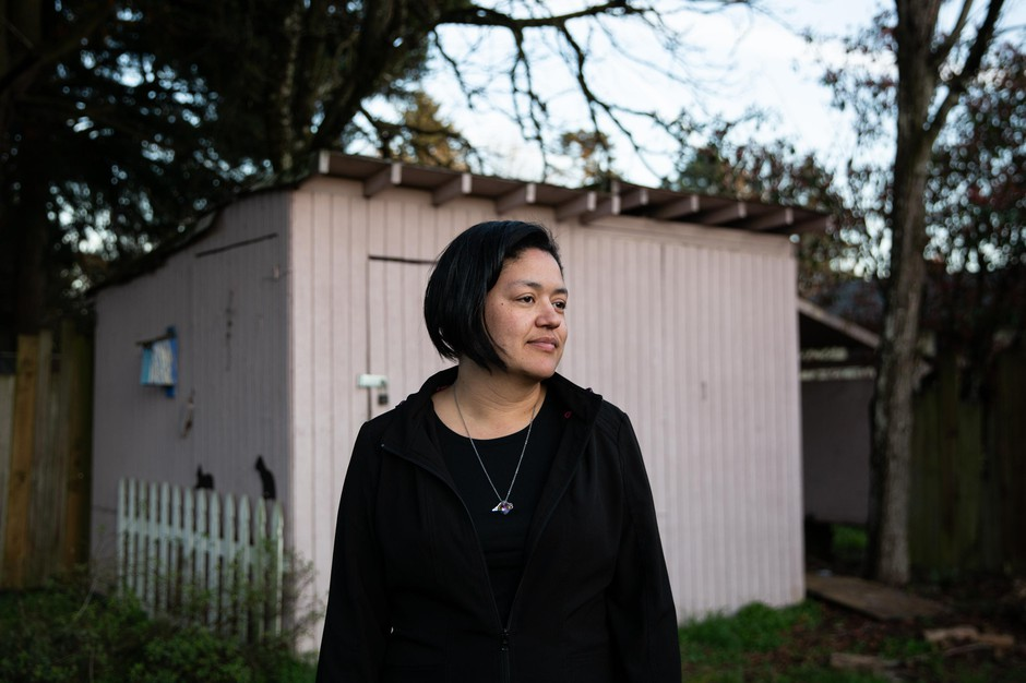 Annelise Neville in the backyard of her home in Portland, Ore., Friday, March 14, 2020. Neville's bartending job at Moda Center was her only source of income and doesn't know where she'll find more work during the large gatherings ban.