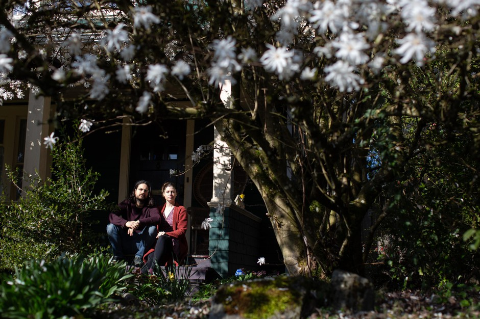 Sam and Lisa Adams of Sama Dams on their front porch in Portland, Ore., Thursday, March 19, 2020.
