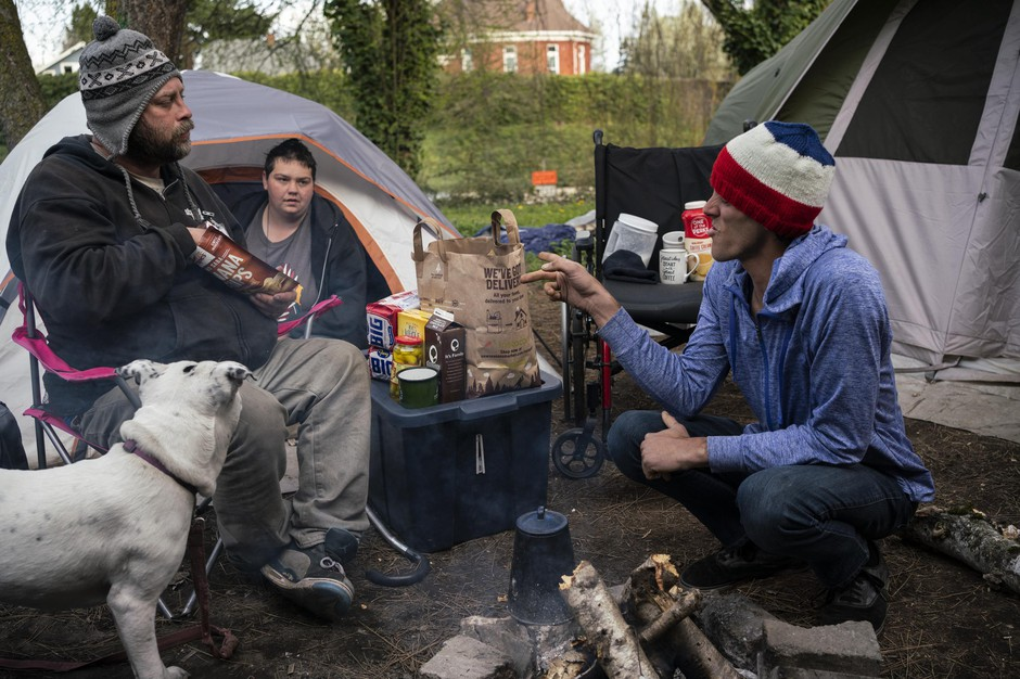 Mike Dusek, Chris Drake, and Raven Drake at their camp on I-5 in North Portland. Drake, a former Navy Corpsman, set up a makeshift medical tent at her camp to help take care of her camp mates and anyone else who might need medical help during the coronavirus pandemic.