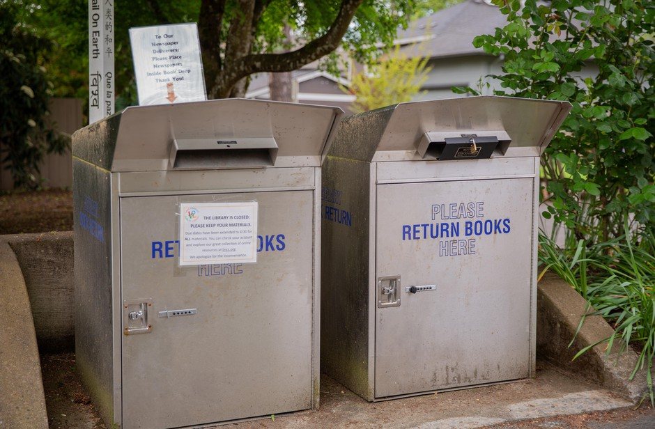 A lock on the book return box at the Lake Oswego Public Library in Lake Oswego, Ore., on Wednesday, April 29, 2020. Lake Oswego closed its public library in response to the coronavirus pandemic.