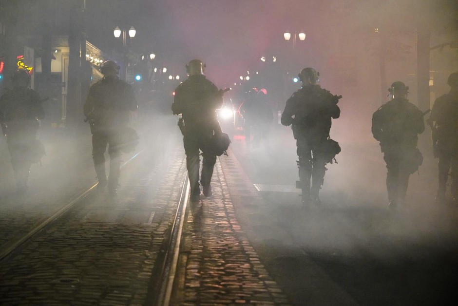 Police deploy tear gas during demonstrations in downtown Portland, Ore., Saturday, May 30, 2020. The death of George Floyd at the hands of a white Minneapolis police officer sparked nationwide protests against police brutality amid the COVID-19 pandemic.