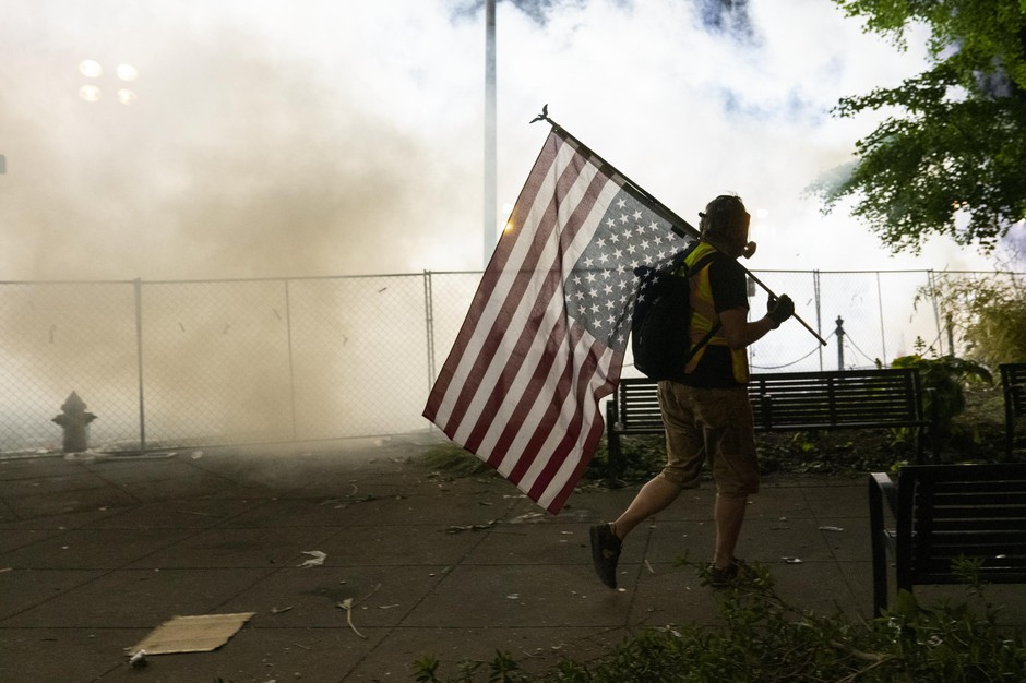 A night of protests against police brutality in Portland, Ore., ended with police using tear gas, flash bangs and rubber bullets to disperse the crowd June 5, 2020, after protesters threw water, fruit and bottles at police and then knocked down the fence separating them.
