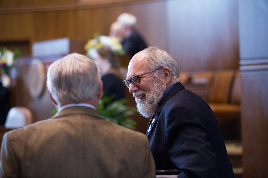 Democratic Oregon state Sen. Arnie Roblan speaks with a fellow state senator before the Oregon Senate convenes at the Oregon Capitol in Salem, Ore., Tuesday, April 2, 2019.