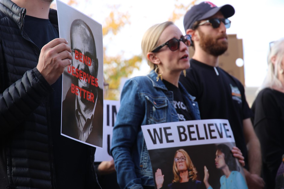 "Protestors outside Bend City Hall on Oct. 3 carried pictures of Nathan Boddie's face with the text ""Bend Deserves Better."""