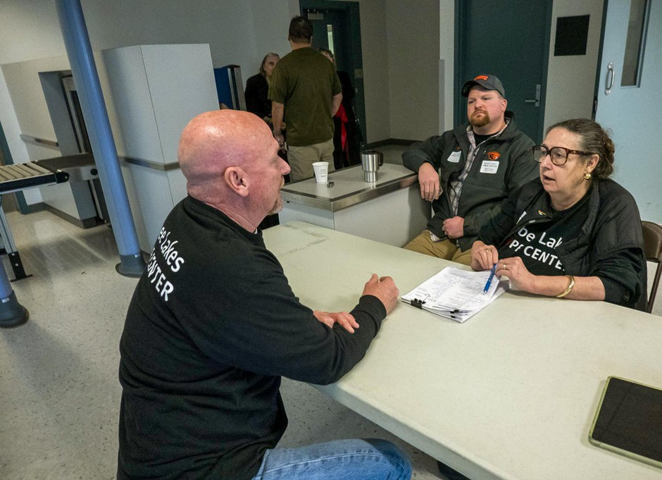Alan Evans, left, chats withState Sen.BetsyJohnson, D-Scappoose, a vocal supporter of the plan to convert the never-used Wapato Jail into a service center for the region's homeless.