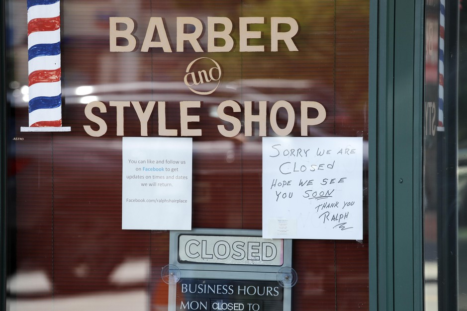 A barber shop remains closed because of the coronavirus outbreak Tuesday, May 19, 2020, in Seattle.