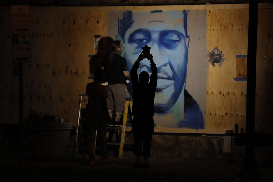 An artist creates an image of George Floyd on Thursday, May 28, 2020, in Minneapolis.