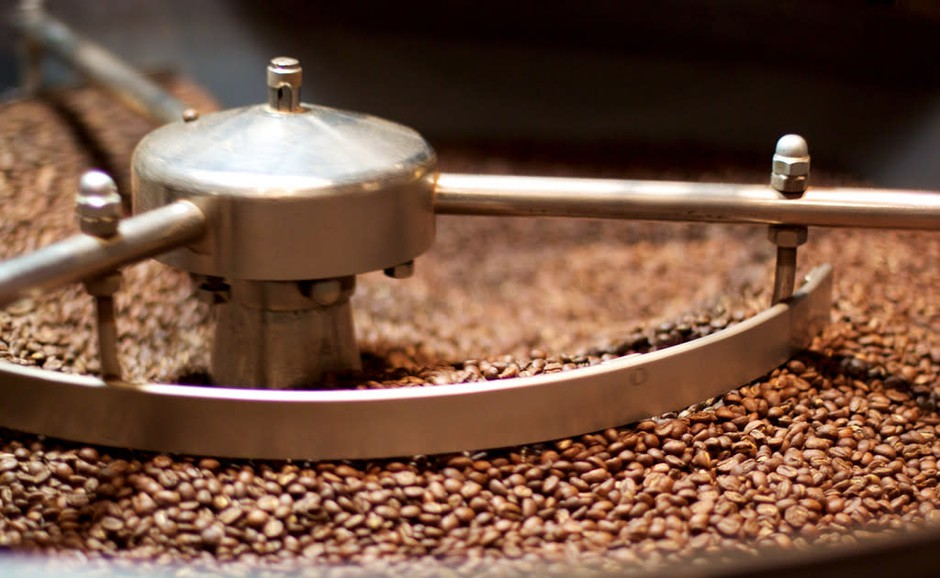 Roasted coffee beans cool down.