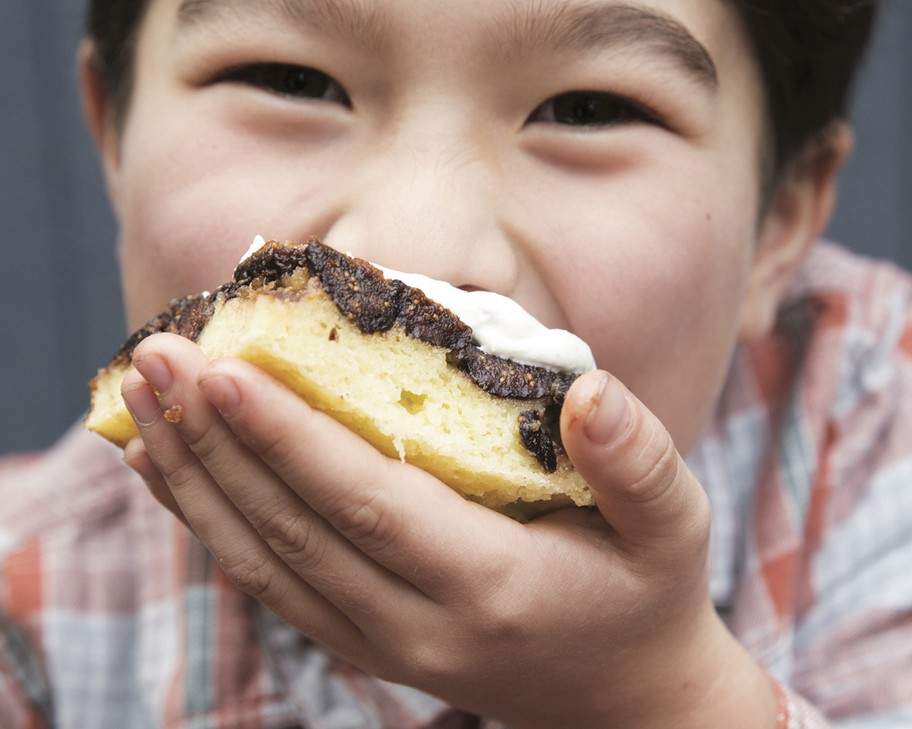 """Rachel Yang's older son, Pike Chirchi, 7, takes a bite of Upside-Down Fig Mochi Cake with Bleu Cheese Whip from her cookbook """"My Rice Bowl, Korean Cooking Outside the Lines."""" The sweet-savory """"dessertish"""" rice cake can be made with dried apricots instead of Missionfigs."""