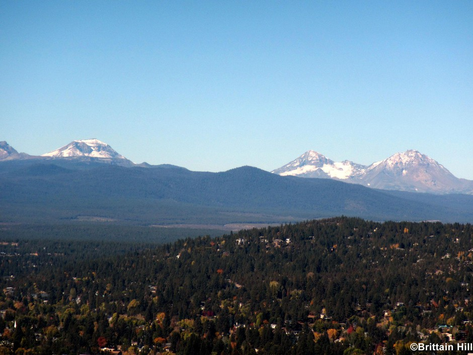 The Tumalo volcanic center as seen from Bend. The tallest point in front of the Sisters, between South and Middle, is Triangle Hill, at the middle of the volcanic center. Other nearby buttes and peaks are also a part of the complex.