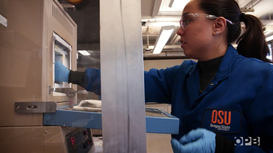 Oregon State University PhD candidate Elizabeth Converse pulls YInMn blue out of the furnace.