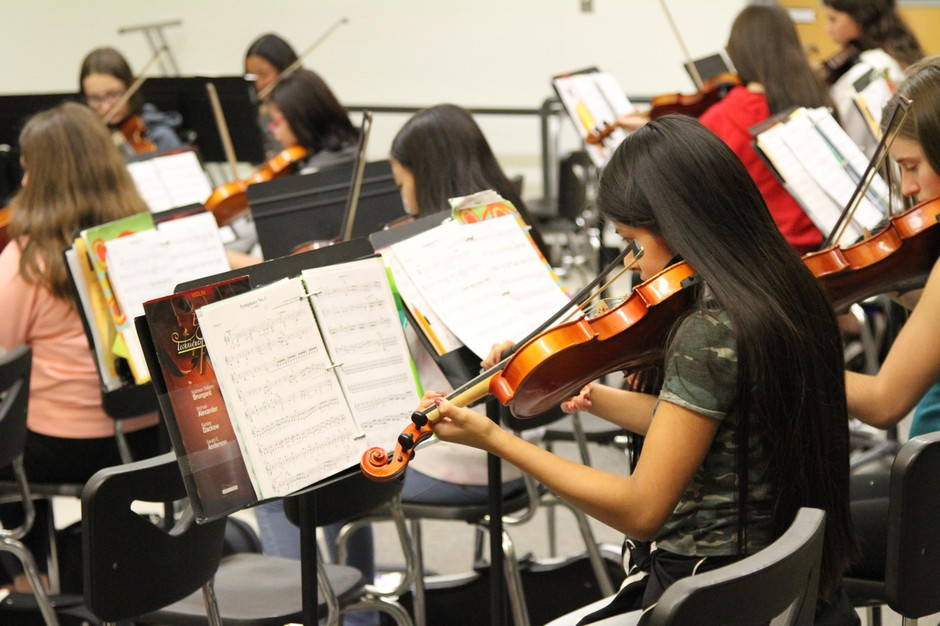 Ashley, a seventh-grader and student in OPB's Class of 2025 project, plays the violin in the school orchestra. With two orchestra classes, she plays her violin every school day.