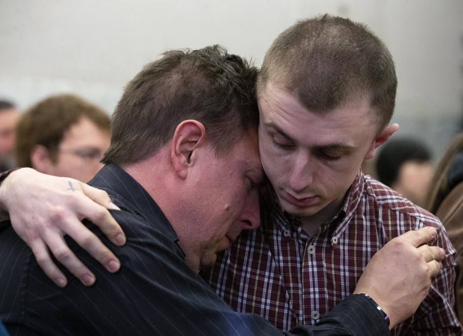 Micah Fletcher, right, comforts someone inside the courtroom during closing arguments at the Jeremy Christian trial in Portland, Ore., on Wednesday, Feb. 19, 2020.
