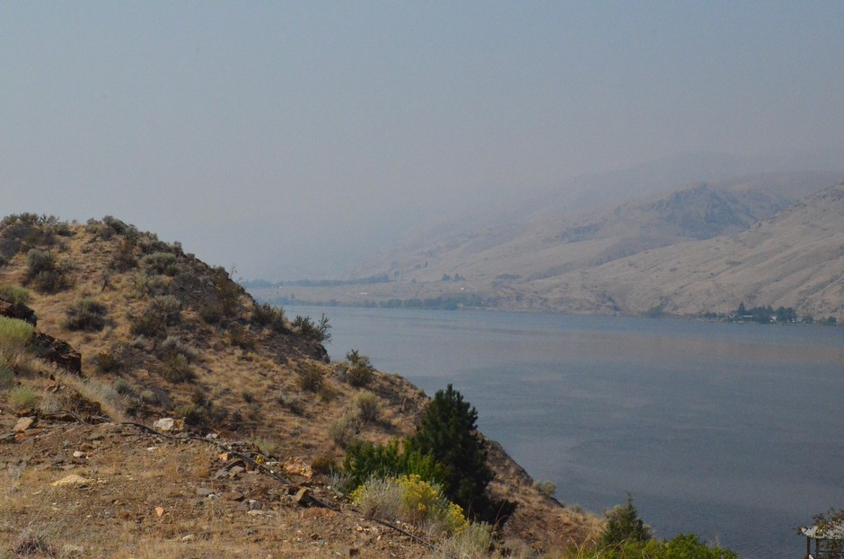 A hazy sky over the Columbia River in Eastern Washington. Fire seasons are now 105 days longer in the western U.S. than they were in the 1970s. That's one reason smoky skies are more common during wildfire season than in the past.