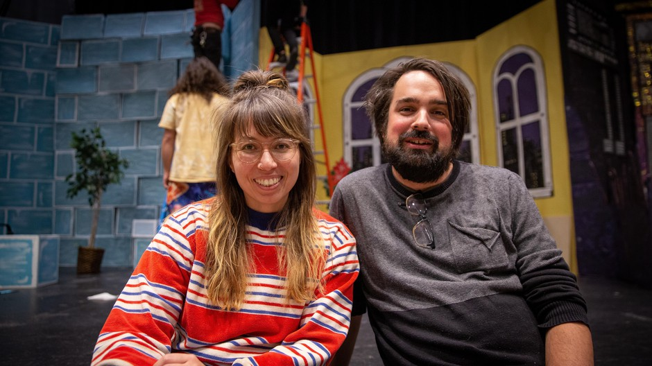 """Writer and director Megan Tabaque (left) with producer Zack Traeger (right), sitting on the Revolution Hallstage where theirsatirical, rock musical, """"Batman ReturnsReturns,""""is getting its Portland premiere."""