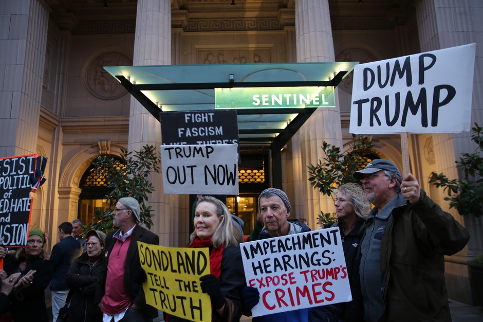 Protesters held up signs outside the entrance of The Sentinel, bringing supportive honks from drivers making their way down SW 11th Avenue, on Tuesday, Nov. 19, 2019, in Portland, Ore.