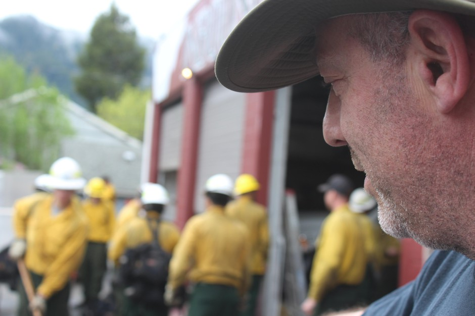 Dillon Sanders looks on as a collection of wildland firefighters train for an upcoming season. Sanders is the owner of Inbound LLC in Oakridge, Oregon, which runs 20-person hand crews and 13 engines for fire suppression.