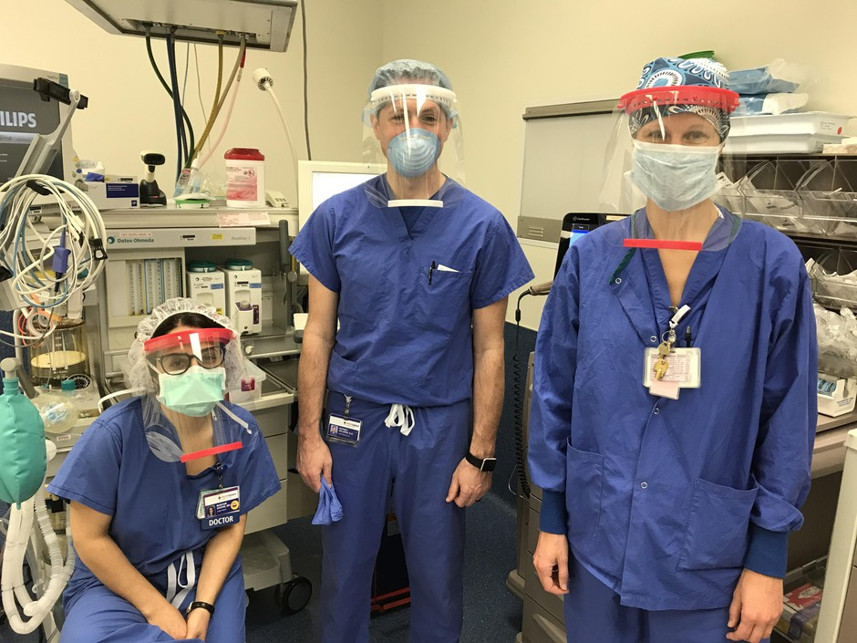 Health care workers at Providence Health wearing 3D printed face shields manufactured and donated by local makers.