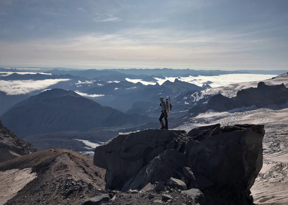 A mountaineer pauses to take in the view as he descends Mount Rainier.