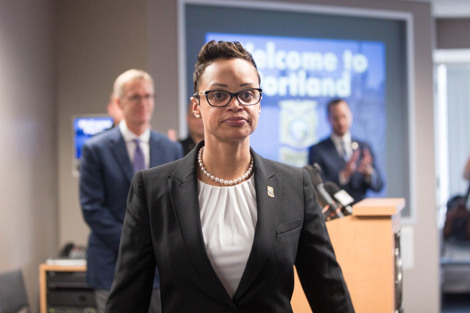 Mayor Ted Wheeler's pick to be Portland's next police chief, Danielle Outlaw, leaves a news conference Thursday, Aug. 10, 2017.