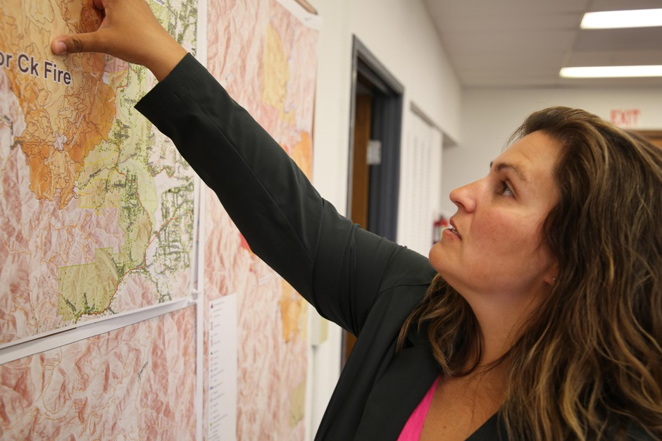 Josephine County Commissioner Lily Morgan points out containment lines on a wildfire threatening homes.