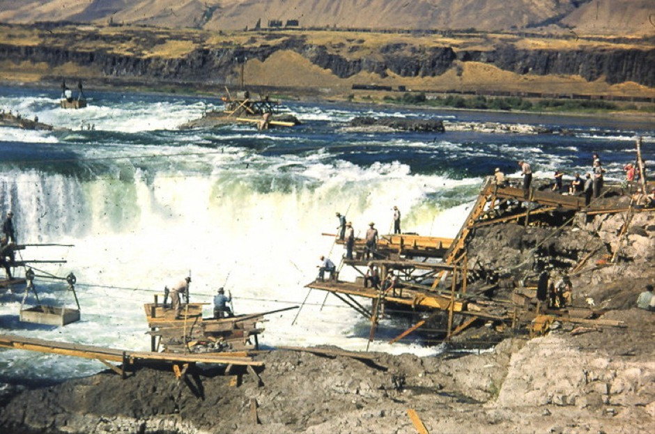 Tribal fishers gather at Celilo Falls in the 1950s before the Dalles Dam backed up the Columbia River, submerging the falls under 40 feet of water.