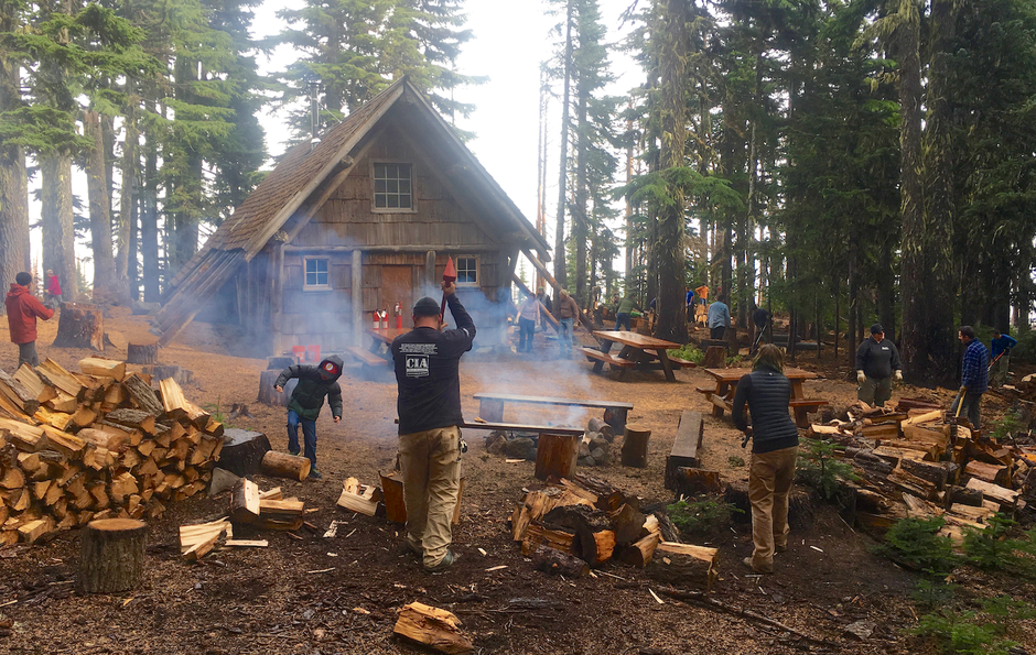 Volunteers cut, split, and stack 10 chords of firewood each October to warm Tilly Jane through the winter.