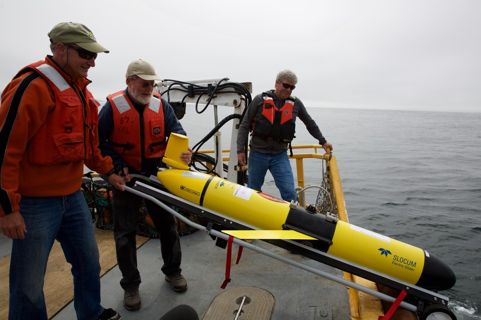 Scientists prepare to launch the Slocum Glider. It'll fly through the ocean for weeks by itself, collecting data on everything from dissolved oxygen to salinity.