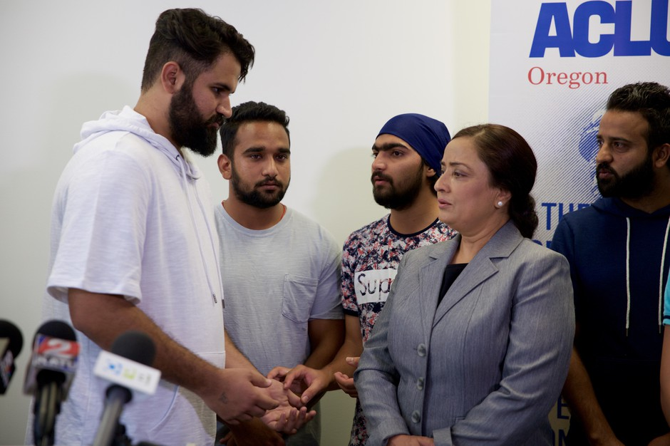 Karandeep Singh, who is seeking asylum from political persecution in India, speaks with an interpreter at a press conference Aug. 22, 2018.