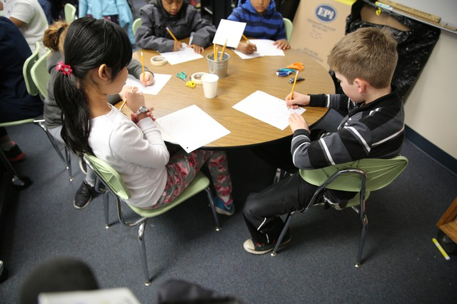 Anna and Johnathan sit at a table together in the classroom they visit once every two weeks, as part of the David Douglas School District program for students identified as Talented And Gifted.