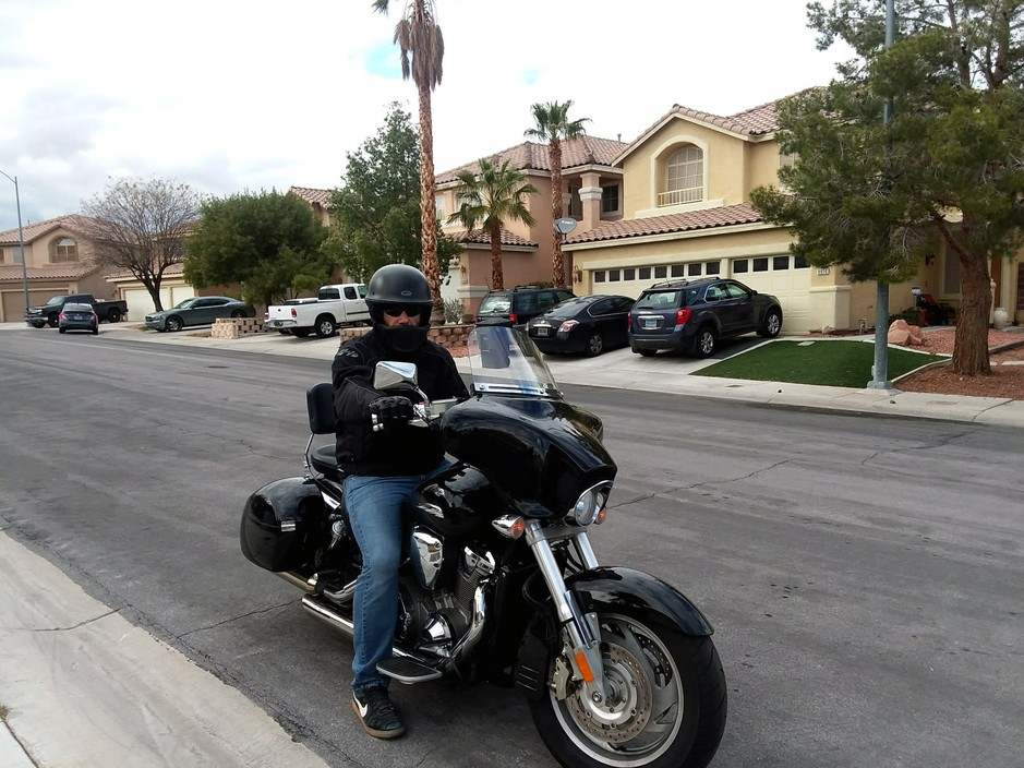 Ali Amhaz, a Legend Solar customer in Las Vegas, rodehis black Honda motorcycle to the company's headquarters to demand a refund on his $28,000 deposit. He's still waiting for payment.